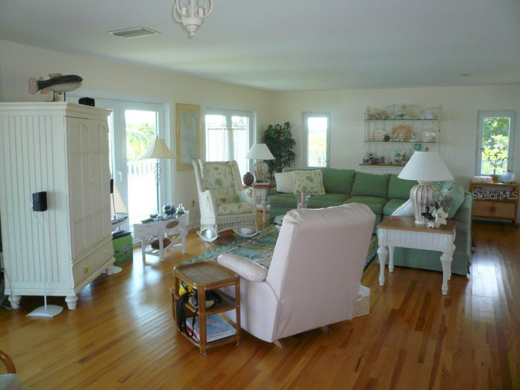 LIVING ROOM - Single Family Home for sale at 170 Kettle Harbor Dr, Placida, FL 33946 - MLS Number is D5900606
