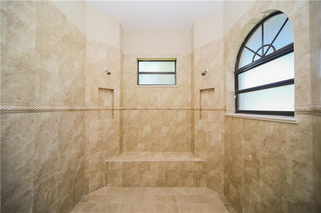 en Suite Bath with Huge Walk-In Shower - Single Family Home for sale at 550 Coral Creek Dr, Placida, FL 33946 - MLS Number is D5917129