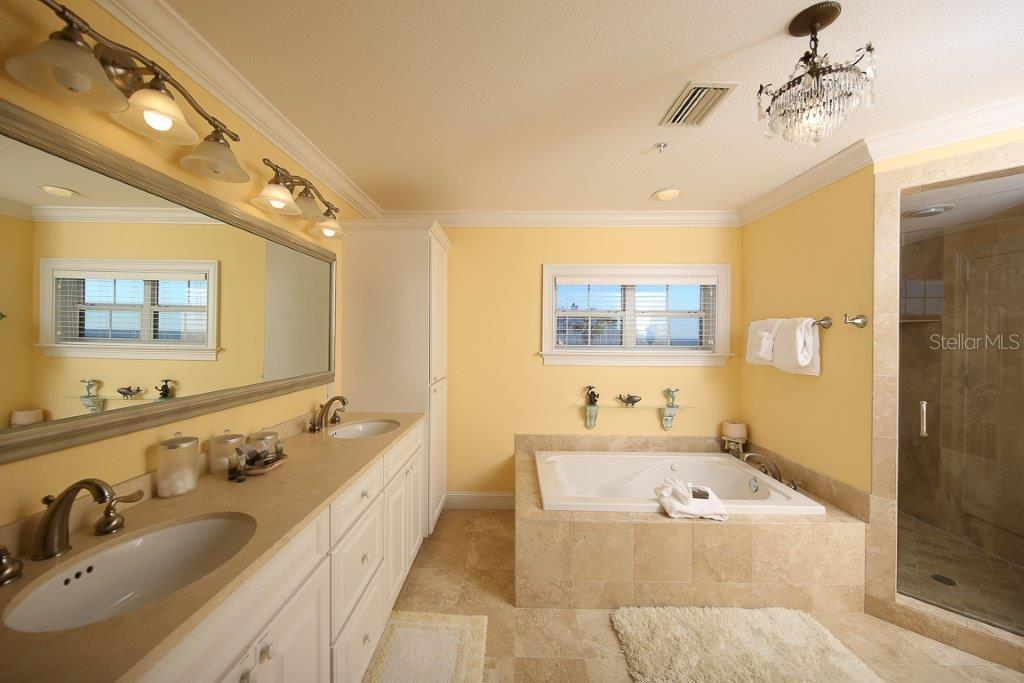 Upstairs Master Bath - Single Family Home for sale at 7020 Palm Island Dr, Placida, FL 33946 - MLS Number is D5917629