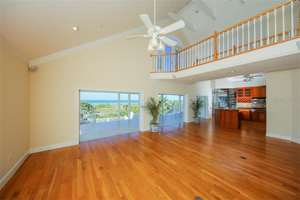 Great Room, Kitchen and Upstairs Balcony - Single Family Home for sale at 7020 Palm Island Dr, Placida, FL 33946 - MLS Number is D5917629
