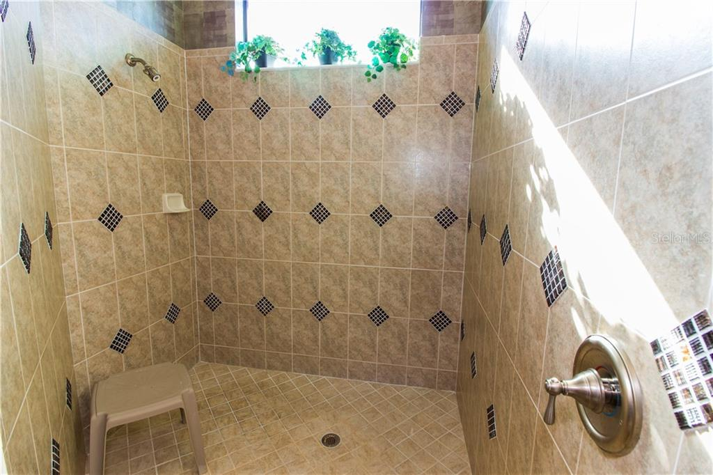 Huge walk-in shower in the master bathroom - Single Family Home for sale at 1855 Batello Dr, Venice, FL 34292 - MLS Number is D5917776