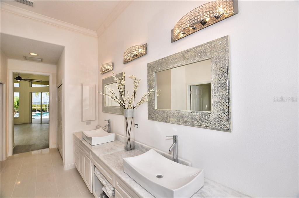 Master bathroom has double sinks with a garden tub and walk in shower, The master closet has wood shelving and measures 8x8 - Single Family Home for sale at 3121 Rivershore Ln, Port Charlotte, FL 33953 - MLS Number is D5917816