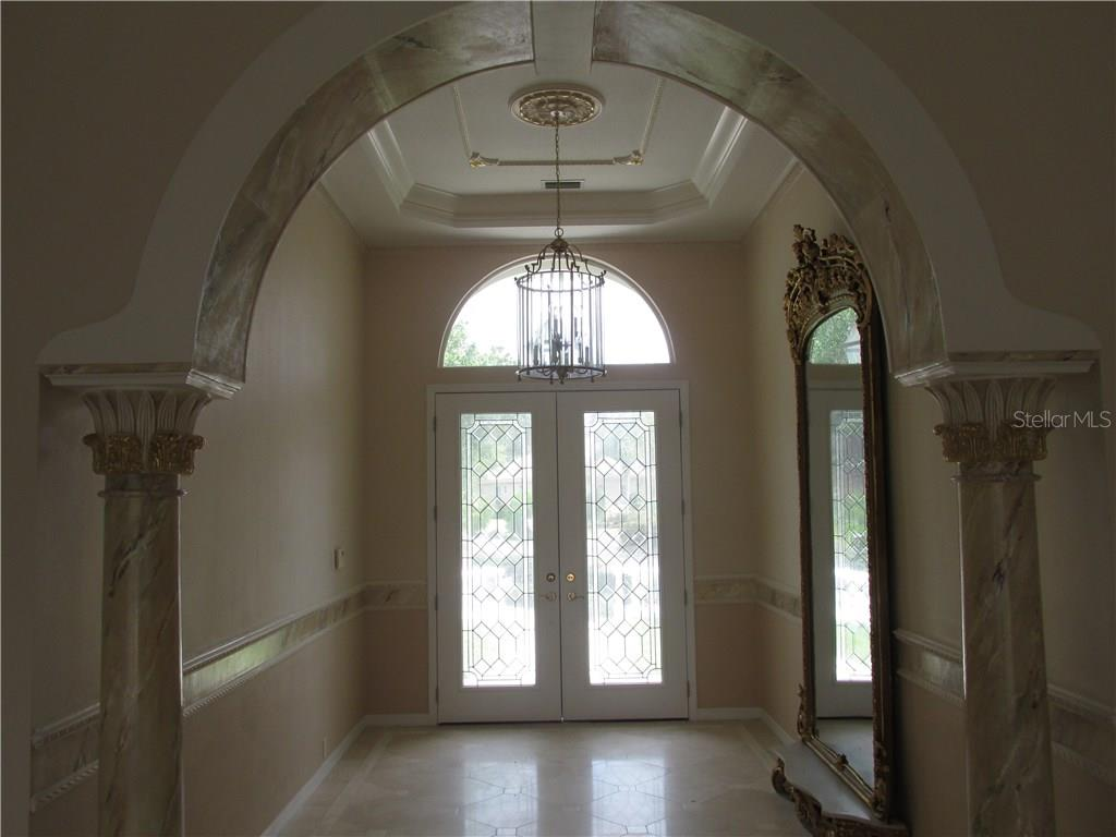 This is a view from the living room looking back into the foyer - Single Family Home for sale at 3001 Rivershore Ln, Port Charlotte, FL 33953 - MLS Number is D5917929