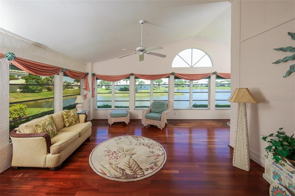 Florida Room with Expansive Lake Views - Single Family Home for sale at 1806 Ashley Dr, Venice, FL 34292 - MLS Number is D5918442