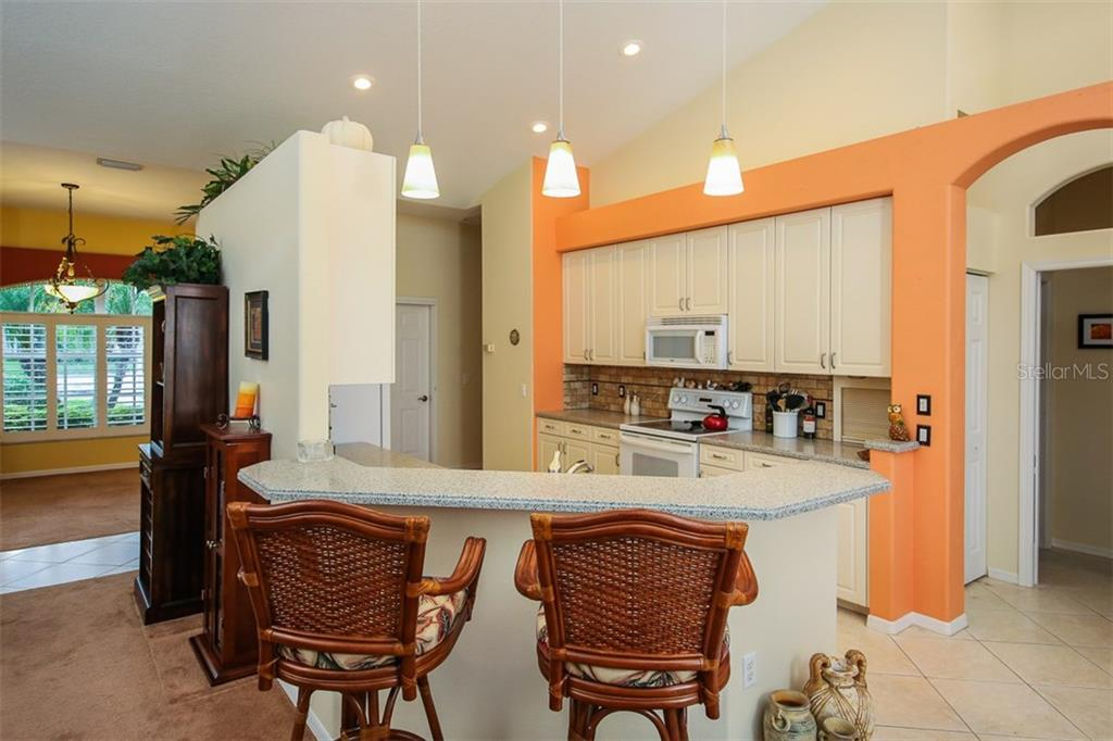 Breakfast Bar and Kitchen - Single Family Home for sale at 5660 Riviera Ct, North Port, FL 34287 - MLS Number is D5919107