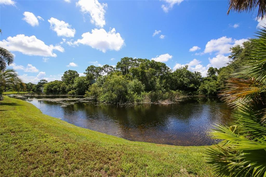 Lake views in rear - Single Family Home for sale at 317 Indian River Ln, Englewood, FL 34223 - MLS Number is D5919375