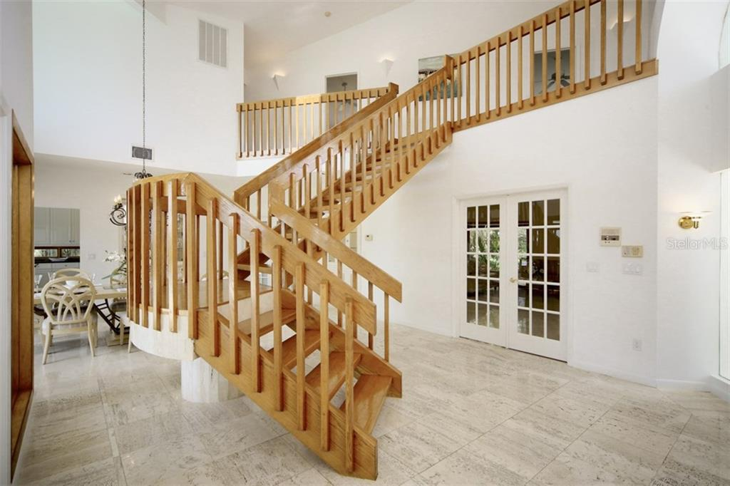 Grand Foyer/staircase - Single Family Home for sale at 1850 Bayshore Dr, Englewood, FL 34223 - MLS Number is D5919513