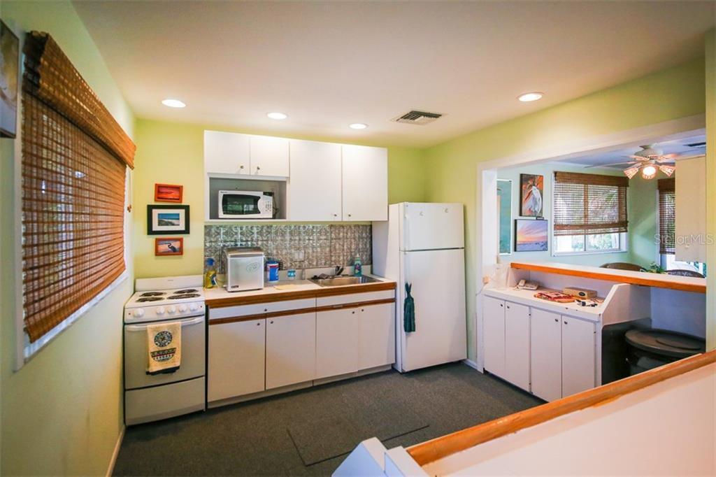 Clubhouse kitchen - Condo for sale at 9200 Little Gasparilla Is #203, Placida, FL 33946 - MLS Number is D5920072