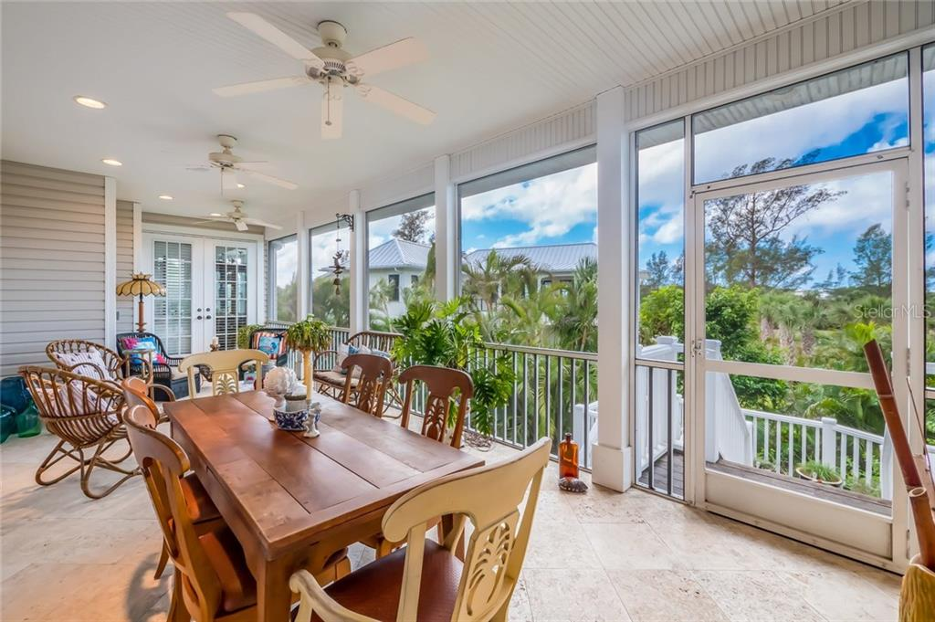 Screened lanai on main level - Single Family Home for sale at 9891 Gasparilla Pass Blvd, Boca Grande, FL 33921 - MLS Number is D5920572