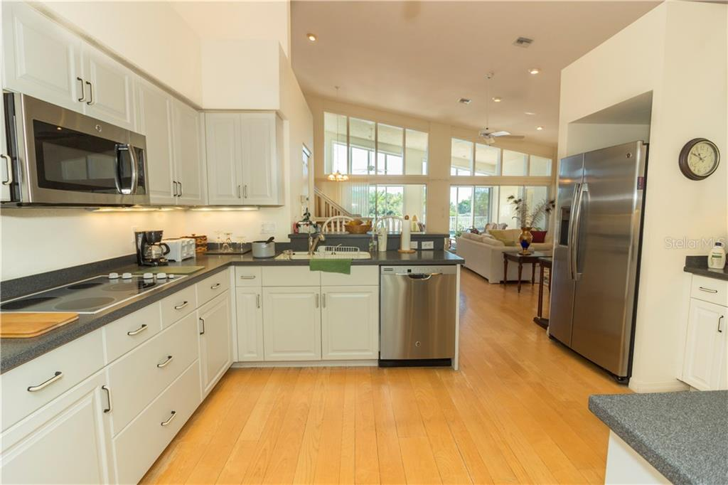 While preparing meals you can still enjoy the view from this large, bright kitchen. - Single Family Home for sale at 1439 Deer Creek Dr, Englewood, FL 34223 - MLS Number is D5921060