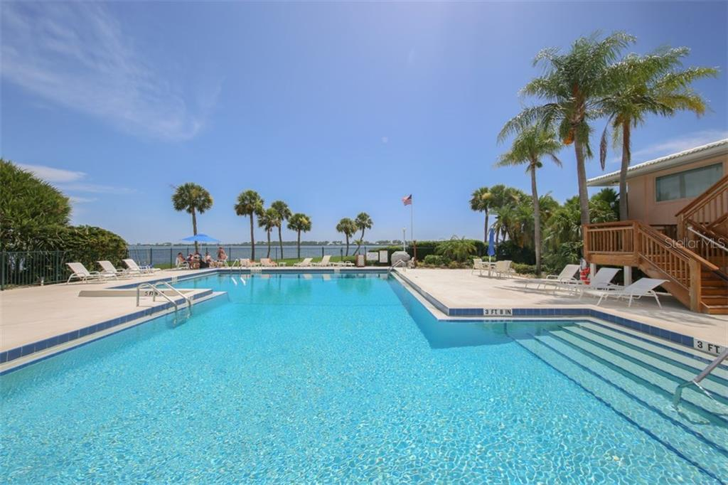 Main pool overlooking Intracoastal - Condo for sale at 11000 Placida Rd #309, Placida, FL 33946 - MLS Number is D5921681