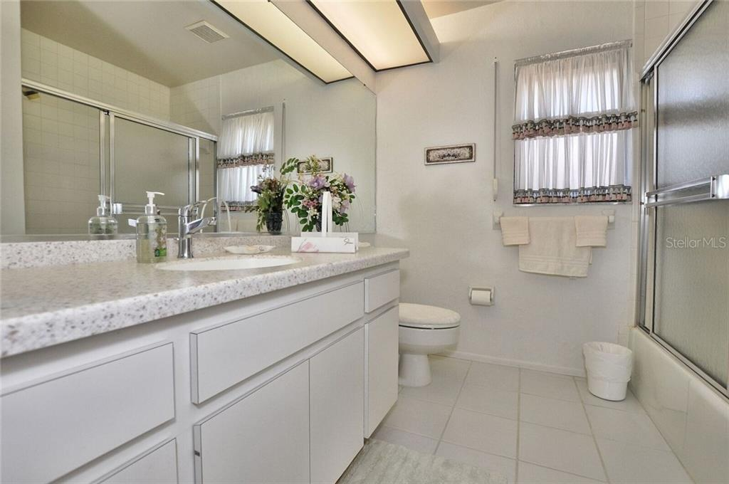 Guest bathroom - Single Family Home for sale at 9 Pine Ridge Way, Englewood, FL 34223 - MLS Number is D5921839