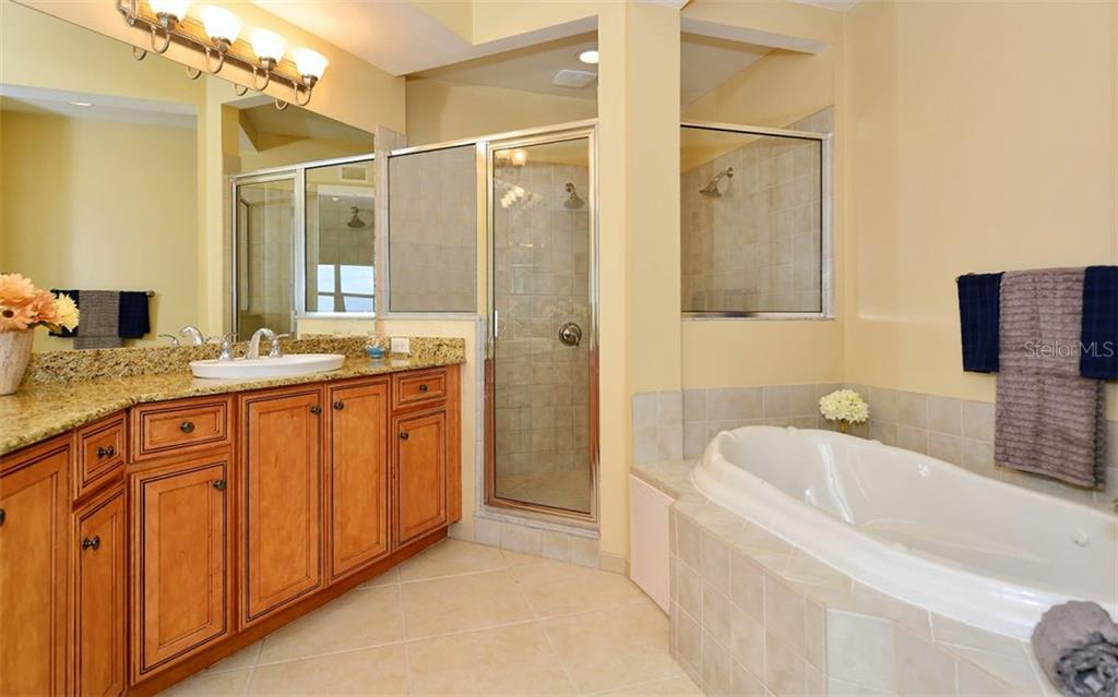 Master Bath with large walk in Shower and soaking tub - Condo for sale at 8561 Amberjack Cir #402, Englewood, FL 34224 - MLS Number is D5923600