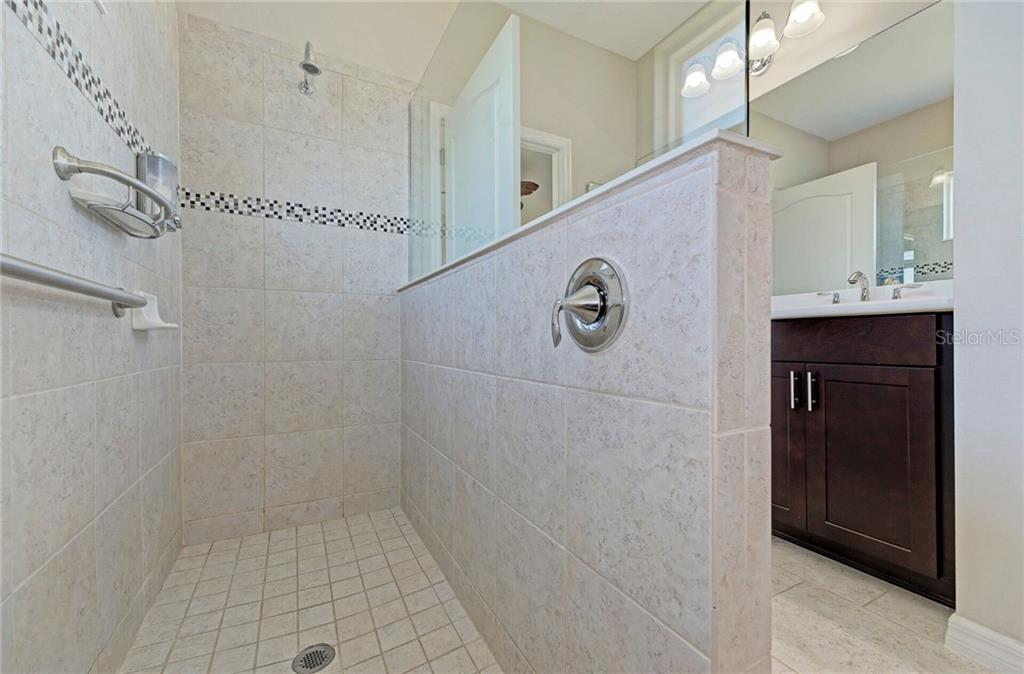 Roman shower with accent tile. - Single Family Home for sale at 141 Avens Dr, Nokomis, FL 34275 - MLS Number is D6100104