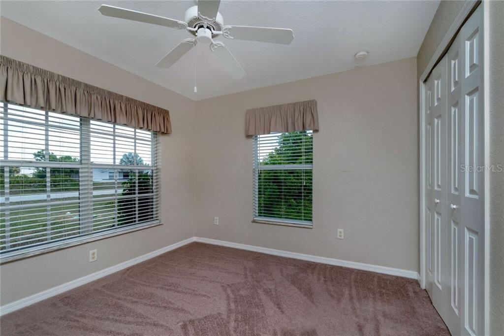 Guest Bedroom - Single Family Home for sale at 11205 Gulfstream Blvd, Port Charlotte, FL 33981 - MLS Number is D6100390
