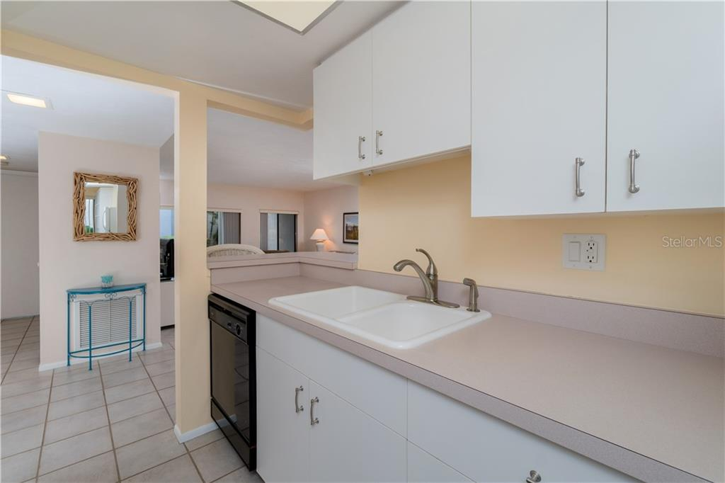 View of Entrance to Kitchen and Breakfast Bar - Condo for sale at 2955 N Beach Rd #b612, Englewood, FL 34223 - MLS Number is D6101147