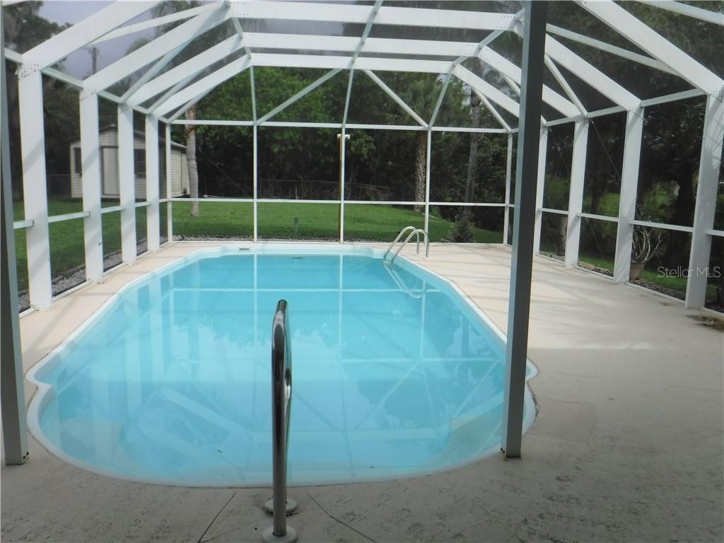 Fiberglass pool is inviting on a warm Florida day. - Single Family Home for sale at 3001 Pellam Blvd, Port Charlotte, FL 33948 - MLS Number is D6101282