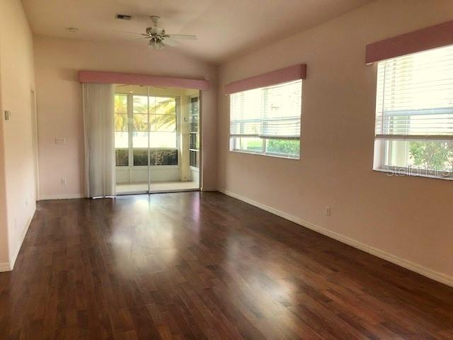 Living room - Villa for sale at 1783 Fountain View Cir, Venice, FL 34292 - MLS Number is D6101496