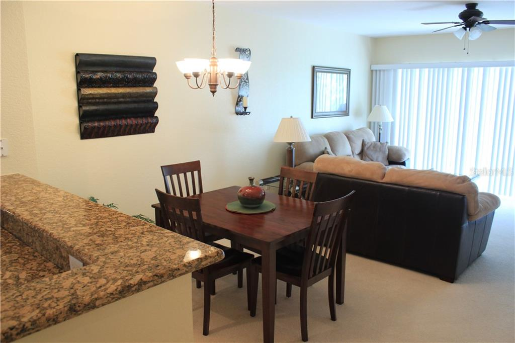 Very casual dining here or on the patio/lanai. - Condo for sale at 8409 Placida Rd #403, Placida, FL 33946 - MLS Number is D6102047