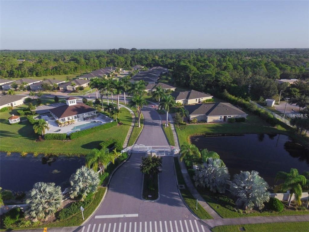 Stillwater Villas has two gated entrances, both are perfectly manicured to highlight this incredible community. - Villa for sale at 29704 Niagara Ct, Englewood, FL 34223 - MLS Number is D6102386