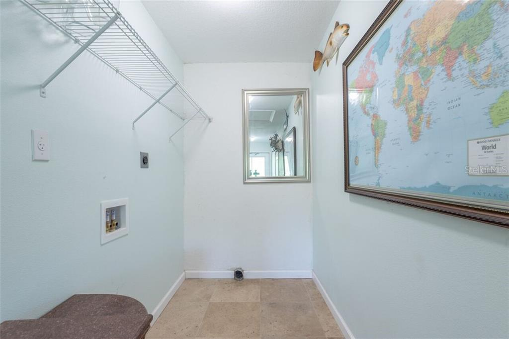 Laundry area has a side door to the outside, a door to the garage and a country style half bath - Single Family Home for sale at 7339 Hawkins Rd, Sarasota, FL 34241 - MLS Number is D6102762