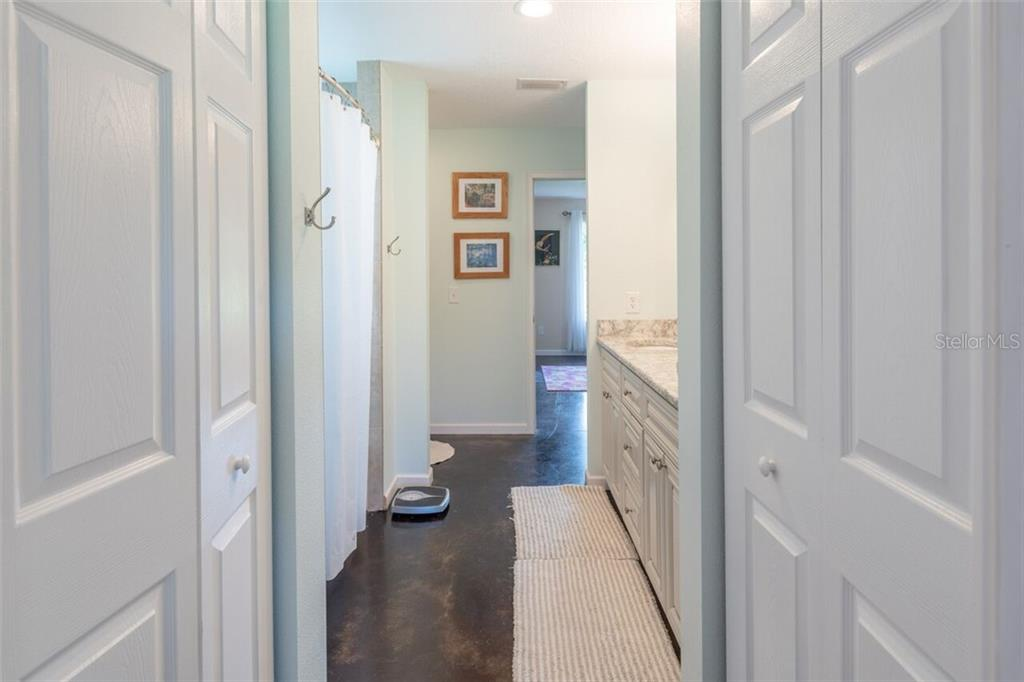 2 linen closets and a thoughtfully designed bathroom serves both bedrooms.  Perfect for guests or older couples who prefer their own private bedroom - Single Family Home for sale at 7339 Hawkins Rd, Sarasota, FL 34241 - MLS Number is D6102762