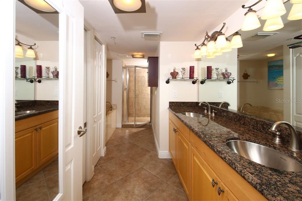 Master Bath with Double Sink Vanity, Separate Tub/Shower - Condo for sale at 50 Meredith Dr #8, Englewood, FL 34223 - MLS Number is D6103644