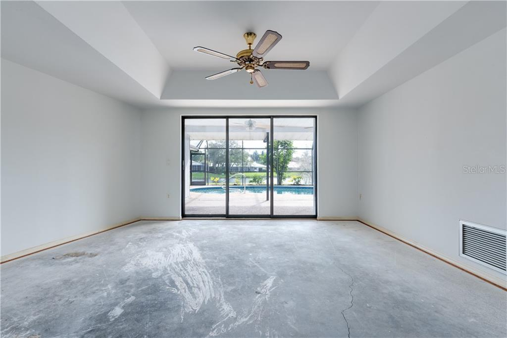 Formal Living Room - Single Family Home for sale at 487 Dover Cir, Englewood, FL 34223 - MLS Number is D6104435