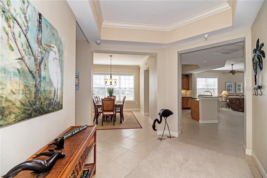 As you enter this lovely home, natural light abounds. - Condo for sale at 8560 Amberjack Cir #101, Englewood, FL 34224 - MLS Number is D6104605