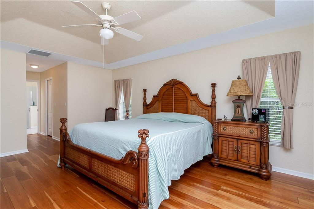 Master bedroom has tray ceiling, ceiling fan and 2 walk in closets. - Single Family Home for sale at 30 Medalist Way, Rotonda West, FL 33947 - MLS Number is D6106239