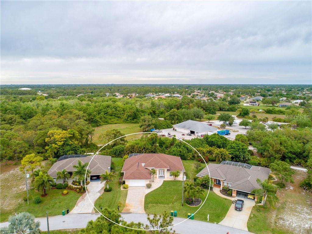 An aerial view of the property and surrounding neighborhood w/other nice homes. - Single Family Home for sale at 30 Medalist Way, Rotonda West, FL 33947 - MLS Number is D6106239