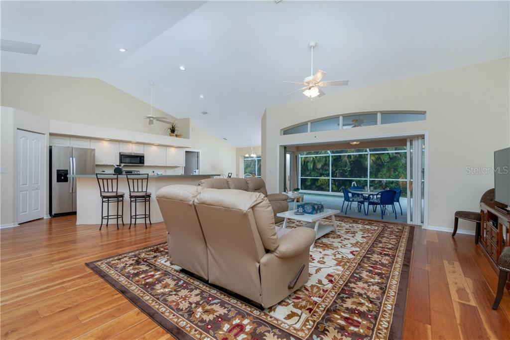 The open floor plan makes it easy to entertain all your guests. - Single Family Home for sale at 30 Medalist Way, Rotonda West, FL 33947 - MLS Number is D6106239