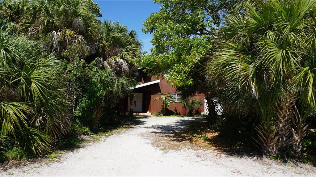 Single Family Home for sale at 6124 Gnarled Oak Dr, Englewood, FL 34223 - MLS Number is D6106347