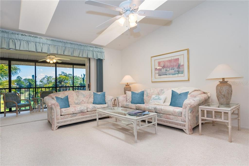 Living room and lanai - Condo for sale at 6800 Placida Rd #271, Englewood, FL 34224 - MLS Number is D6106459