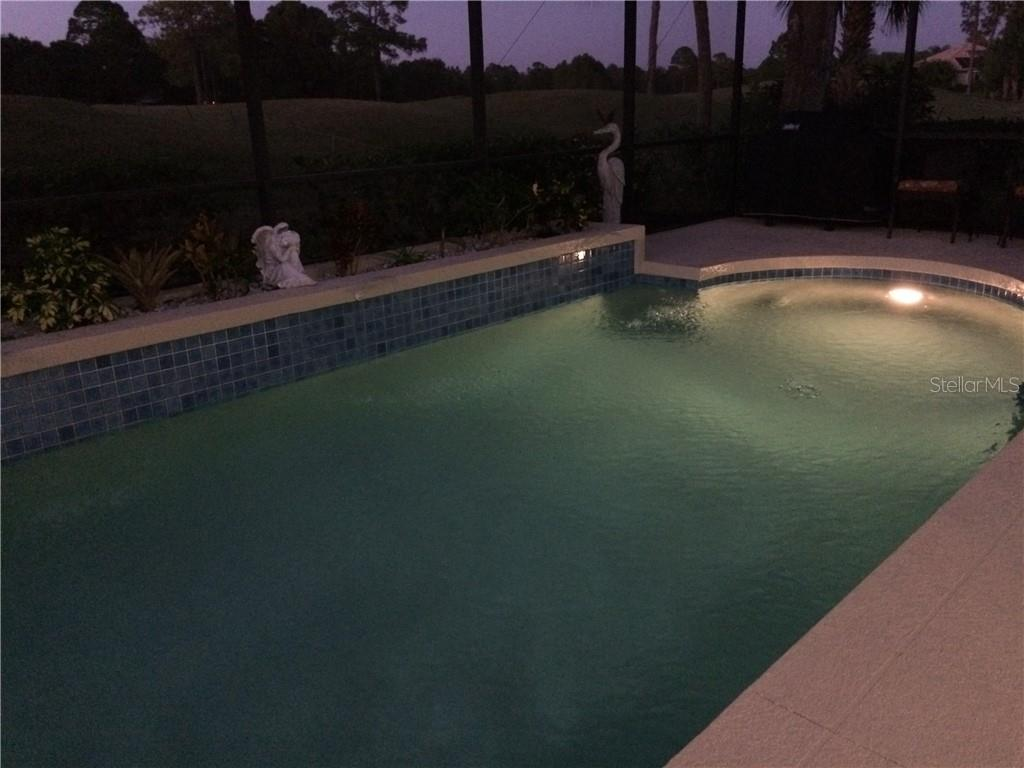 NIGHT SHOT OF POOL - Single Family Home for sale at 2373 Silver Palm Rd, North Port, FL 34288 - MLS Number is D6107376