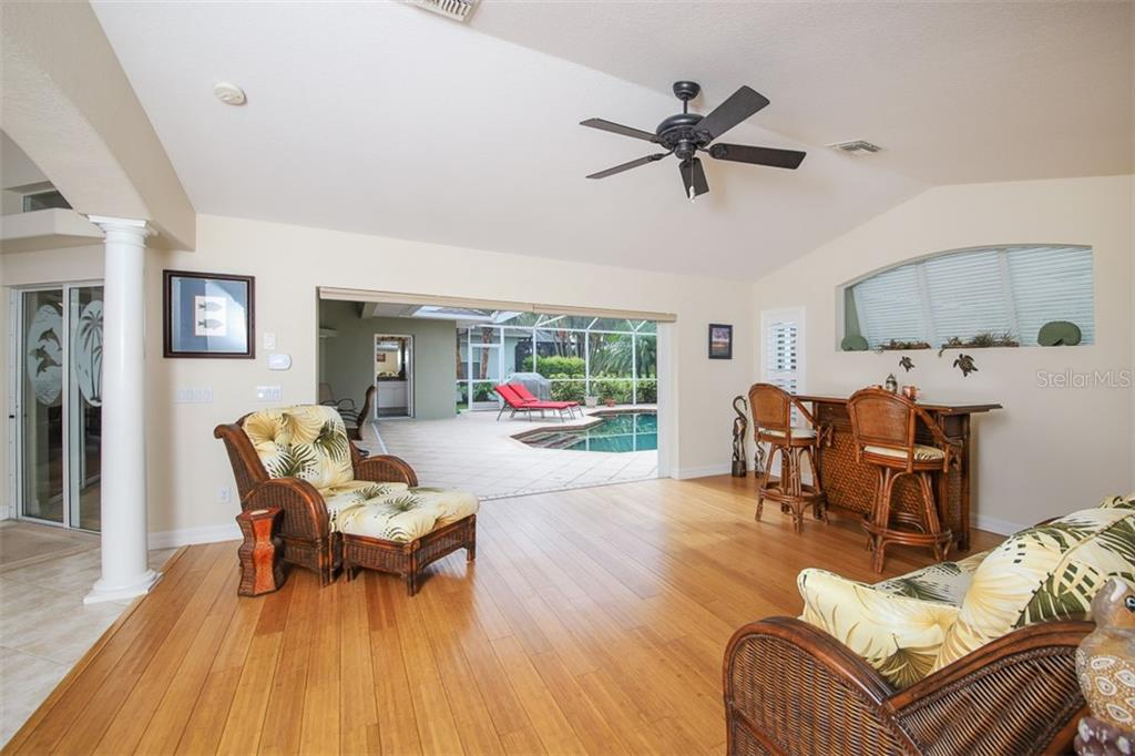 Family Room extends out to pool & lanai - Single Family Home for sale at 254 Rotonda Blvd E, Rotonda West, FL 33947 - MLS Number is D6107401