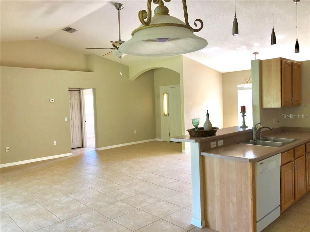 Great Room & Front Door Entrance - Single Family Home for sale at 2291 Meetze St, Port Charlotte, FL 33953 - MLS Number is D6107685