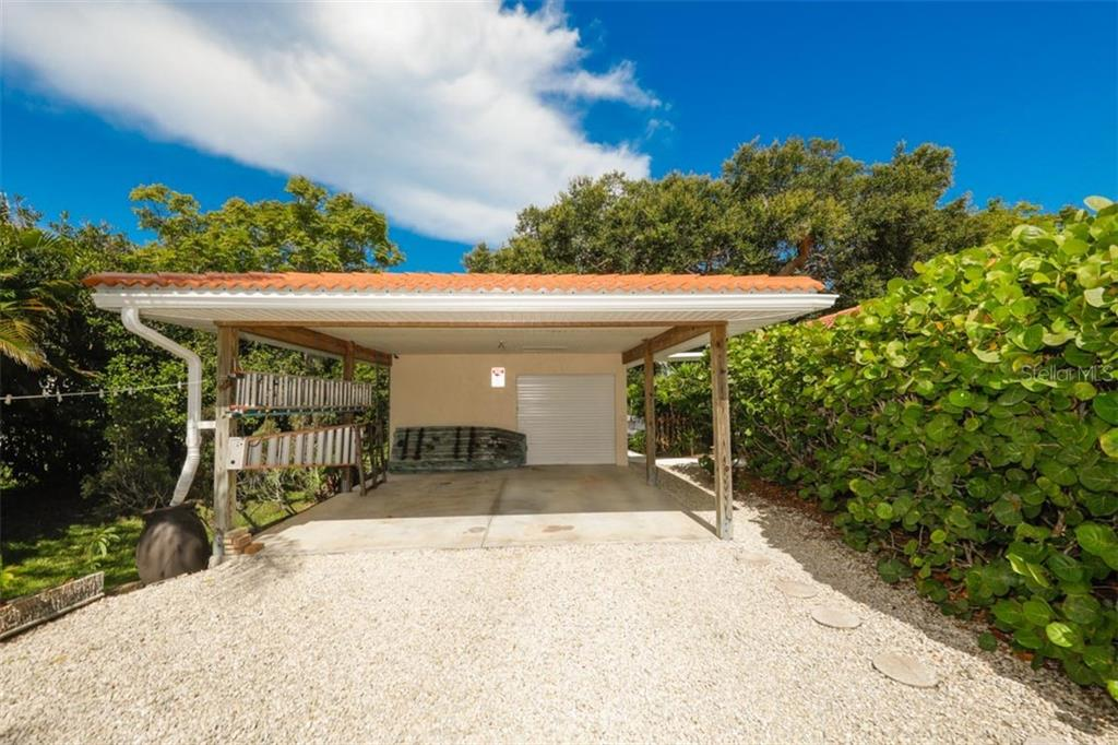 Carport & Workshop - Single Family Home for sale at 140 S Oxford Dr, Englewood, FL 34223 - MLS Number is D6108024