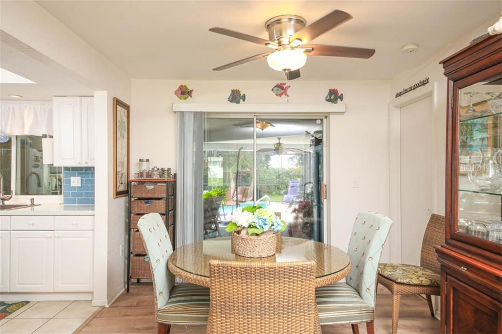 dining area with view to pool - Single Family Home for sale at 913 Tropical Ave Nw, Port Charlotte, FL 33948 - MLS Number is D6108061