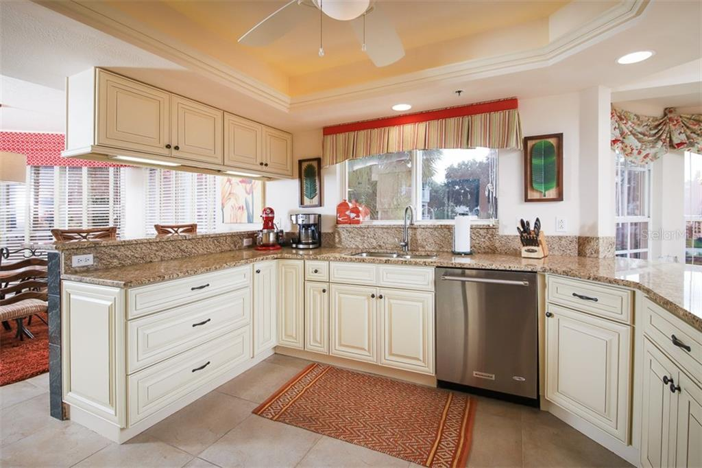 Updated kitchen features tray ceiling with accent lighting, granite & stainless appliances - Condo for sale at 11000 Placida Rd #2301, Placida, FL 33946 - MLS Number is D6108434