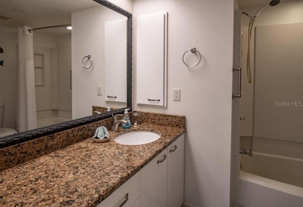 Master bathroom with new granite countertop. - Condo for sale at 7070 Placida Rd #1223, Placida, FL 33946 - MLS Number is D6108523