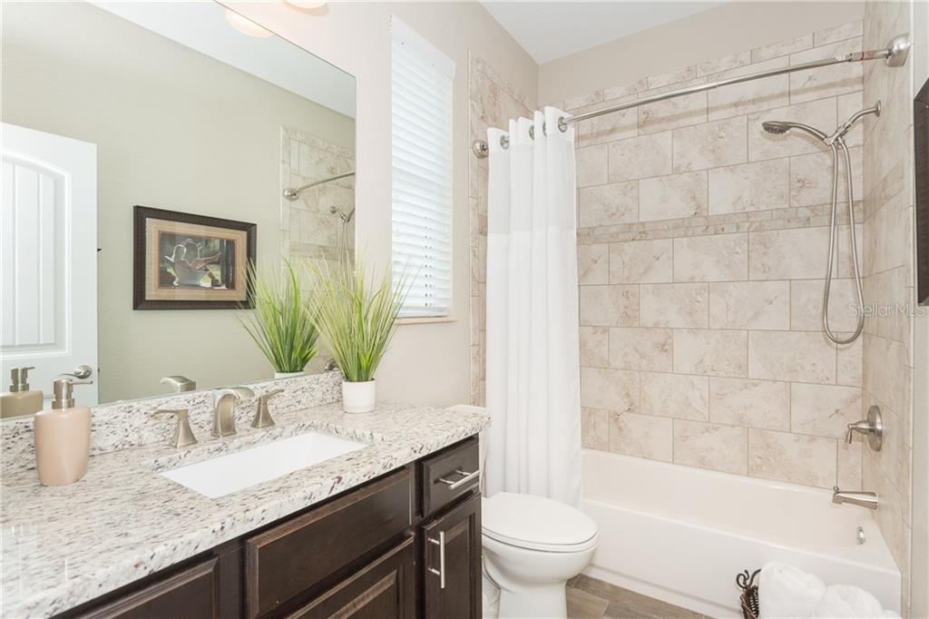 2nd Bath Suite Bathroom - Single Family Home for sale at 130 Jade St, Rotonda West, FL 33947 - MLS Number is D6108653