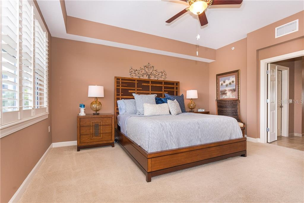 Grand Master Bedroom - Condo for sale at 8561 Amberjack Cir #202, Englewood, FL 34224 - MLS Number is D6109771