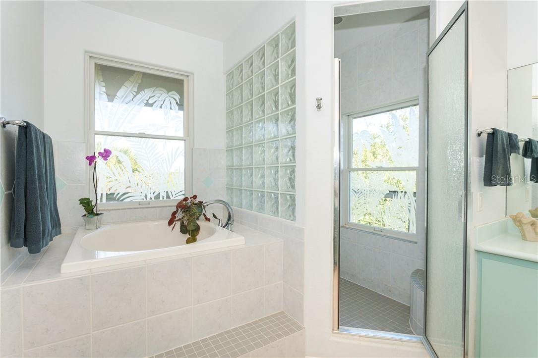 Master Bathroom Shower and Soaker Tub. - Single Family Home for sale at 5 Pointe Way, Placida, FL 33946 - MLS Number is D6110468