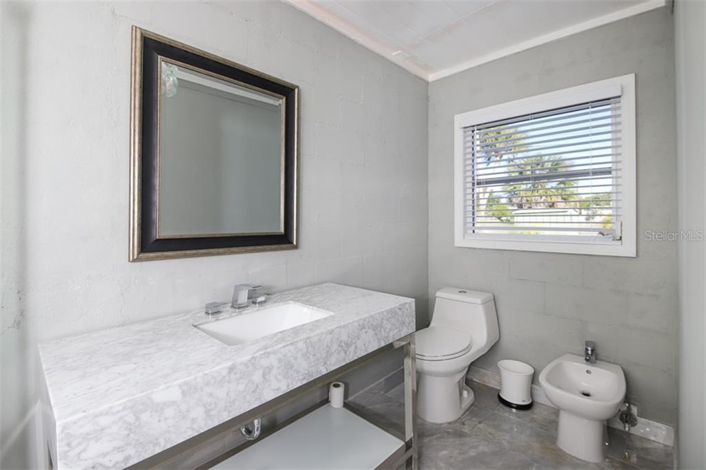 Currently the Master Bedroom - Single Family Home for sale at 1030 E 2nd St, Englewood, FL 34223 - MLS Number is D6110643