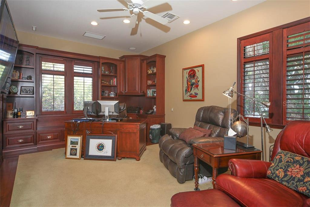 OFFICE WITH PLANTATION SHUTTERS AND BUILT IN BOOKCASE! - Single Family Home for sale at 500 Anchor Row, Placida, FL 33946 - MLS Number is D6111649