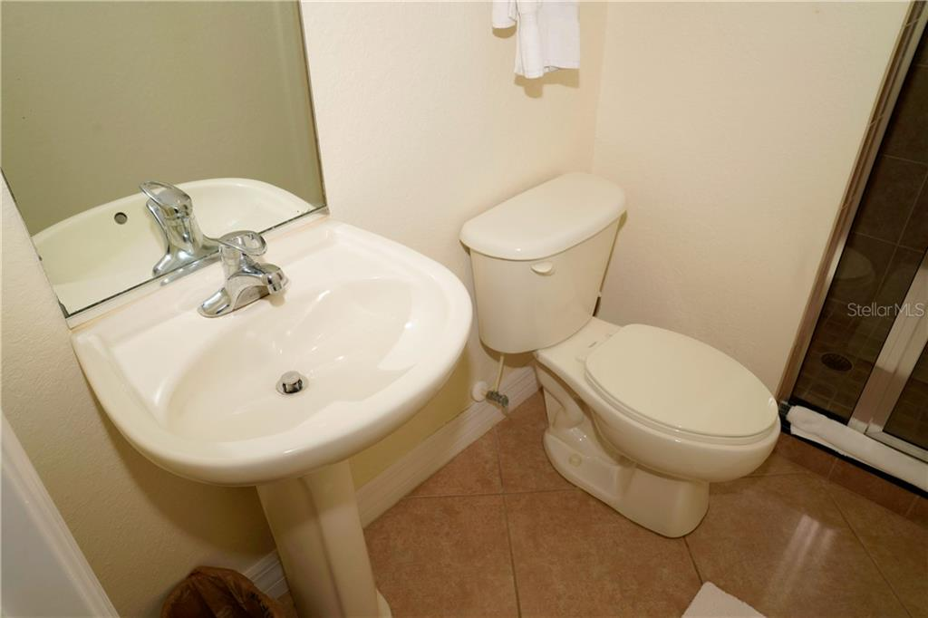 Full bathroom w/shower off 2nd bedroom - Condo for sale at 2245 N Beach Rd #304, Englewood, FL 34223 - MLS Number is D6112346