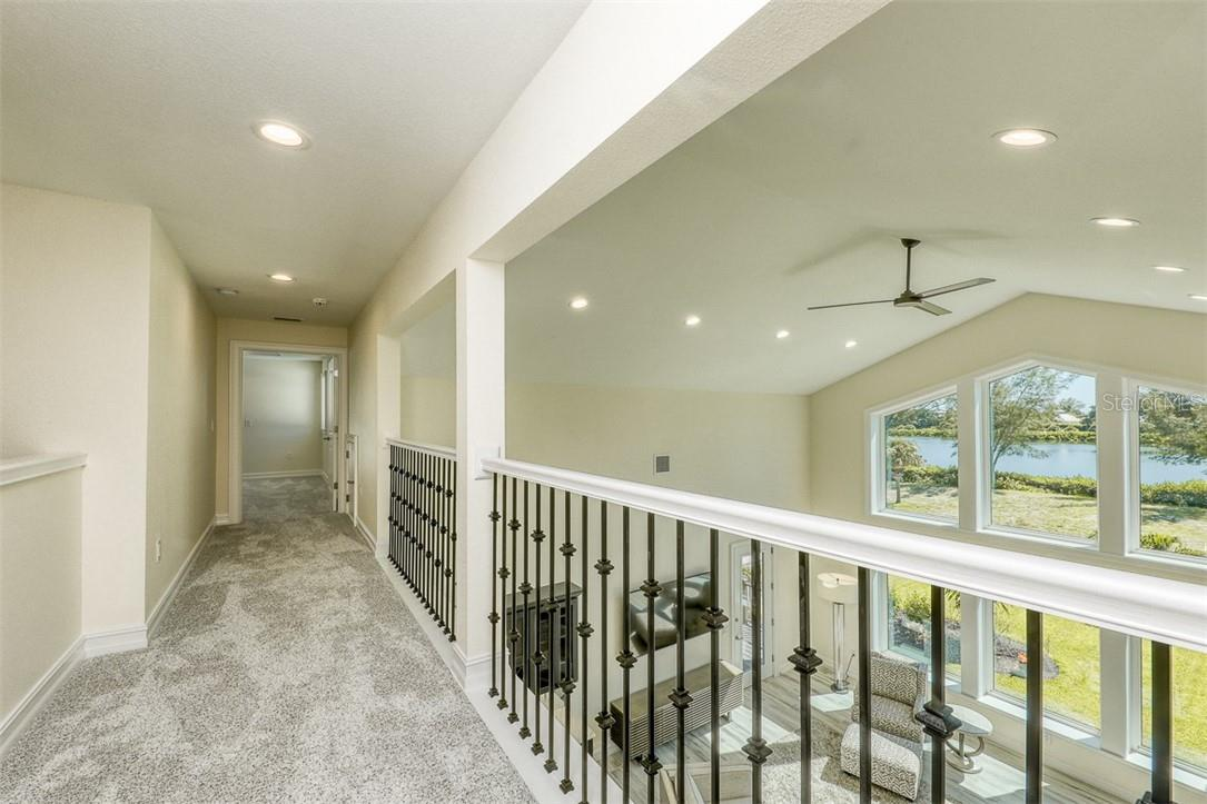 Stairwell on 3rd floor & Utility Closet access - Single Family Home for sale at 16070 Gulf Shores Dr, Boca Grande, FL 33921 - MLS Number is D6112557