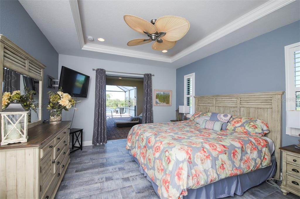 Master Bedroom extends to lanai & has beautiful lake views - Single Family Home for sale at 226 Spring Dr, Rotonda West, FL 33947 - MLS Number is D6113095