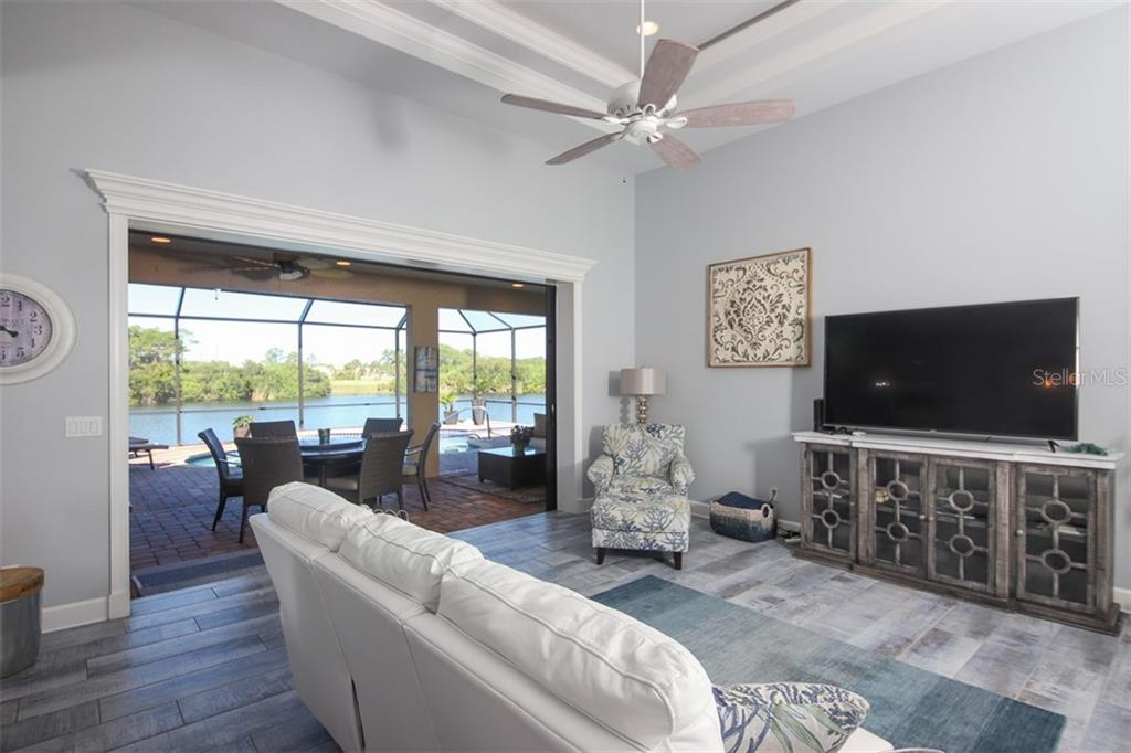 Living Room overlooking pool & lake - Single Family Home for sale at 226 Spring Dr, Rotonda West, FL 33947 - MLS Number is D6113095